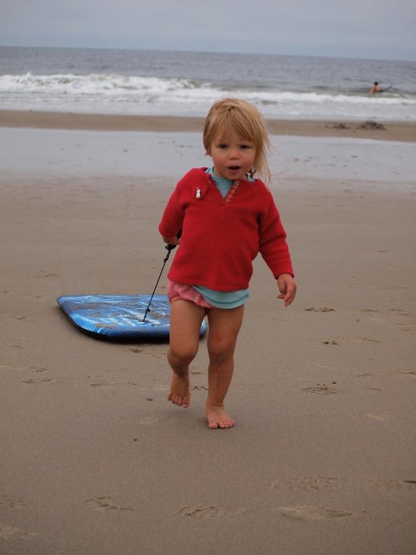 Kid walking on beach of Biddeford Pool